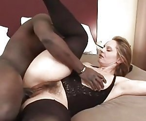 Blonde wife gets her hairy pussy fucked by big black cock
